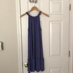 Blue flowered sleeveless dress.
